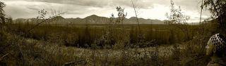 Мы уже прошли половину  трудного и тяжелого пути пересекли границу Якутии и Магаданской области. Сусуманский район, где то там у гор пос.Адыгалах. Когда то перевалочная база для осужденных, место куда свозили в приемный пункт намытое золото с маленьких золото копательных  артелей, потом поселок Дорожников, сейчас место где живут два отшельника из близ лежащего  пос.Мяунджа. Безлюдный и печальный, уже почти полностью слившийся с природой. Когда люди покидают жилище, дома и вещи попросту умирают.