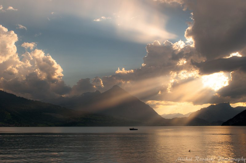 light, ,golden, ,lake, ,sunrays, ,mountains, ,summer, ,boat, ,sunset, ,clouds, ,sky Golden lightphoto preview