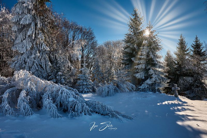 Winter landscap with old wooden crossphoto preview