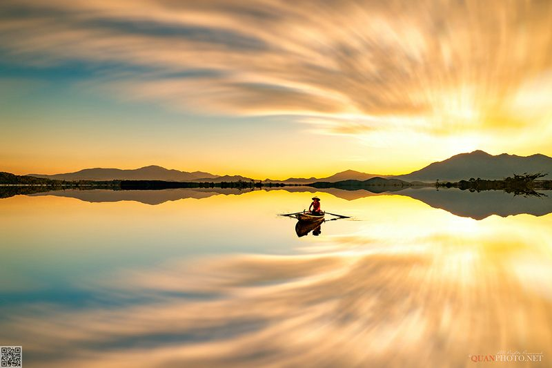 quanphoto, landscape, sunset, sundown, reflections, lake, mountains, art, twirl_effect, rural, countryside, boat, vietnam Twirl Effectphoto preview