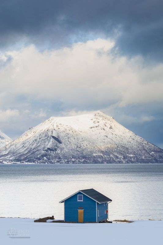 norway,tromso,cabin,building,house,north,northern,mountains,seascape,blue, Blue Cabin with seascape viewphoto preview