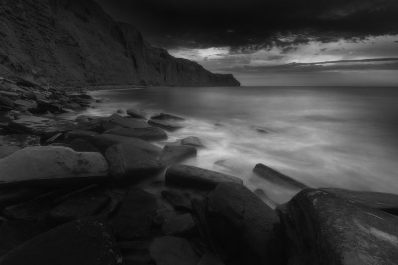 Поглащает море камни фото превью