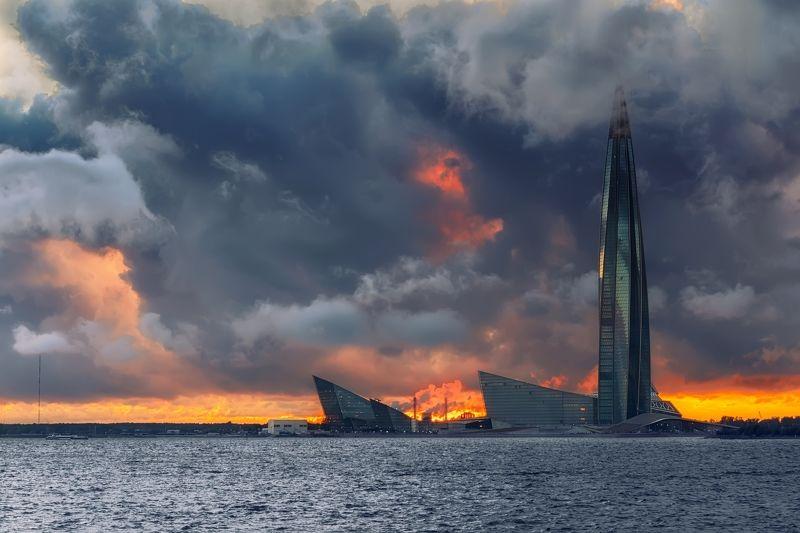 город море вечер закат небо облака ненастье архитектура башня Дождливый деньphoto preview