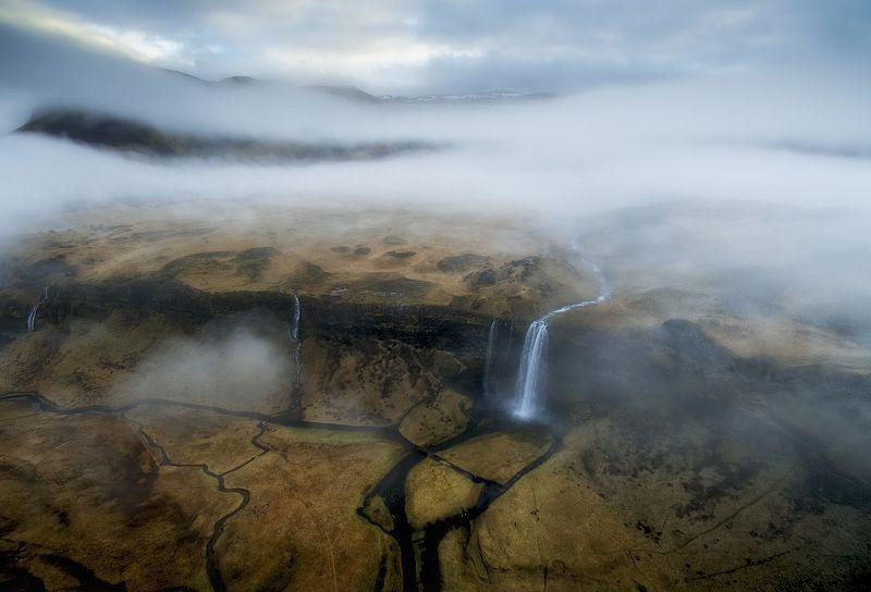сильяналандфосс водопад исландия дронофотография Над облакамиphoto preview