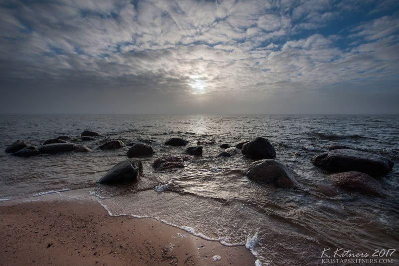 sea seascape fog smoke sun light water sky clouds stone reflection latvia The Foggy Lightphoto preview