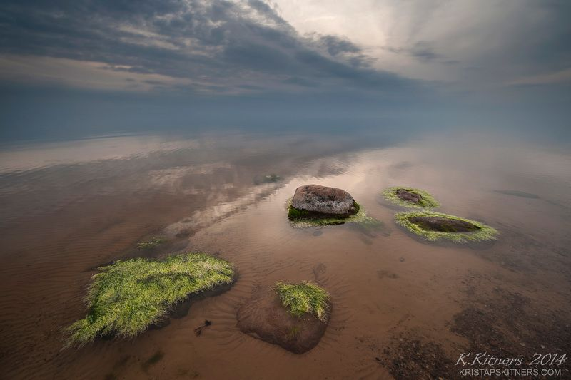 sea seascape water grass fog sky clouds stone reflection sunset evening latvia The Hairy Stonesphoto preview