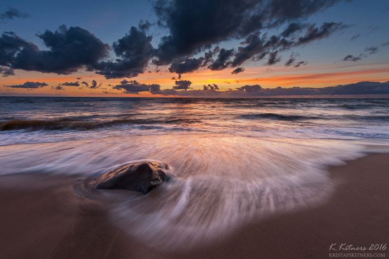 sea seascape water wave sky clouds stone reflection sunset evening latvia The Stone And Wavephoto preview