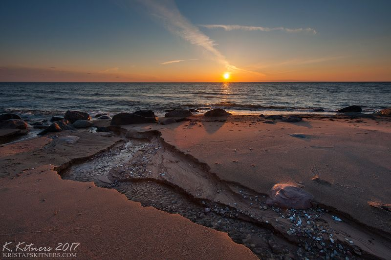 sea seascape water river wave sky clouds stone reflection sunset evening latvia The Last Turnphoto preview