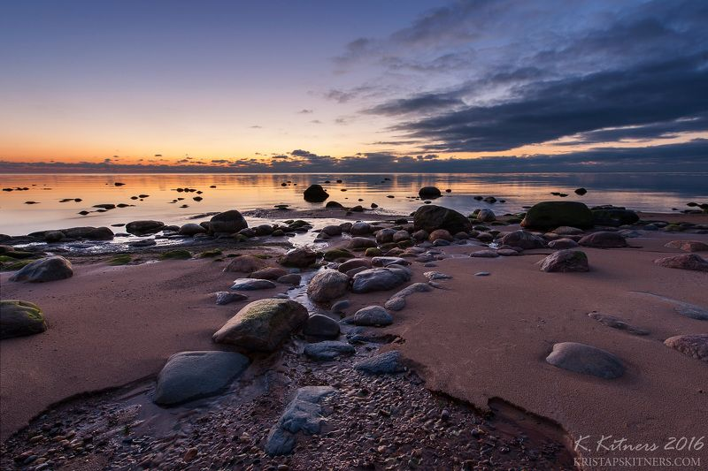 sea river seascape water sky clouds stone reflection sunset evening latvia The Bright Nightphoto preview