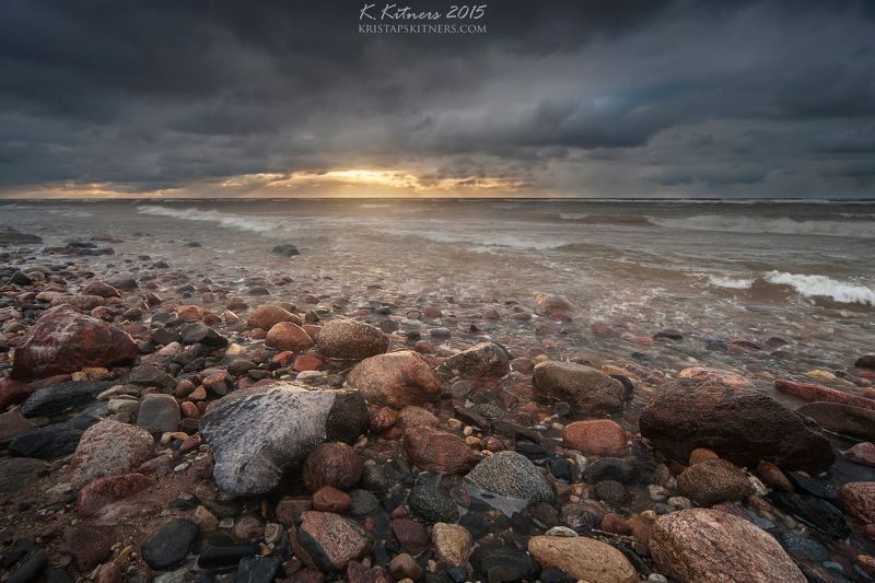 sea seascape water grass fog sky clouds stone reflection sunset storm evening latvia Late Light On Stonesphoto preview