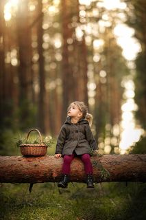 Little girl in a magical forest