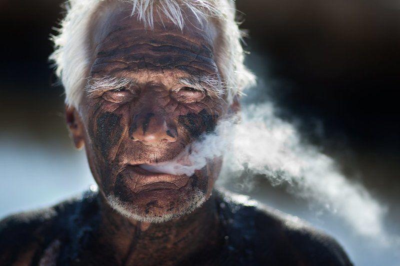 mud bath, smoke, old man, wrinkles, salt mine near sea Mud bathsphoto preview