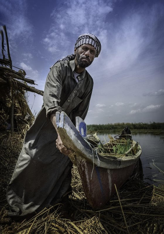 Marshes,Southern Iraq,Boy,cane,Water,sky  marsh hunterphoto preview