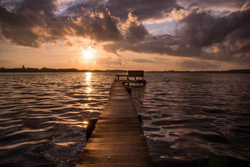 sunset on the lake water mirror sunlight footbridge wood path poland dranikowski sun sky clouds Sunset on the lakephoto preview