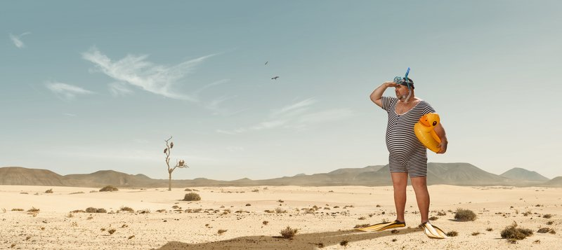 humor,funny,fat,man,swim,desert,dry,heat,looking,searching,beach,snorkeling Should be somewhere...photo preview