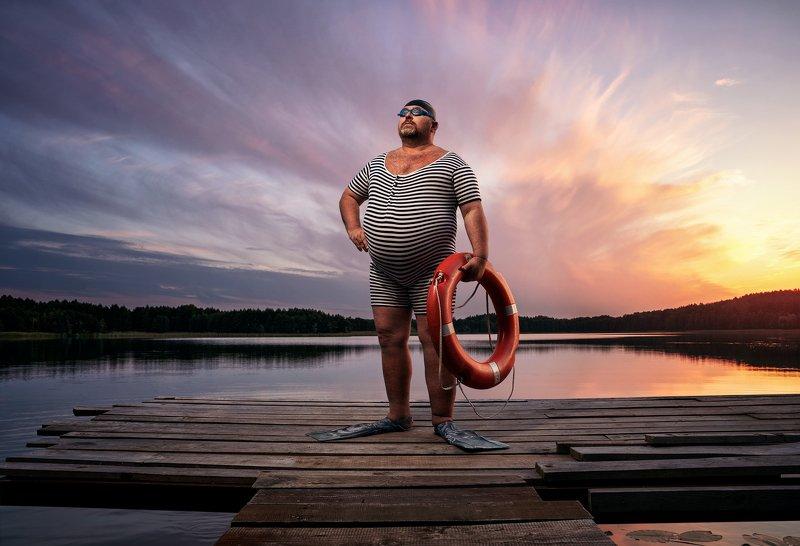 humor,funny,fat,man,portrait,swim,swimmer,lake,sunset The swimmerphoto preview